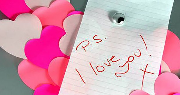 Paper valentines with I love you note.