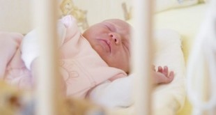 Infant sleeping in a crib